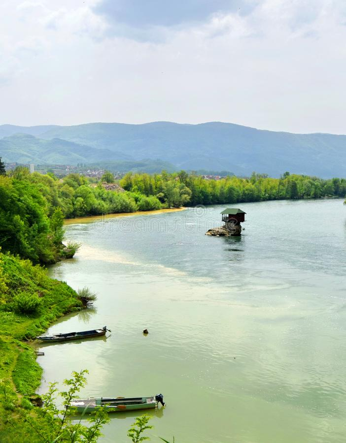 Drina River House Serbia. Drina River House. This tiny house stands on an exposed rock in the middle of the Drina River, near the town of Bajina Basta, Serbia royalty free stock photos