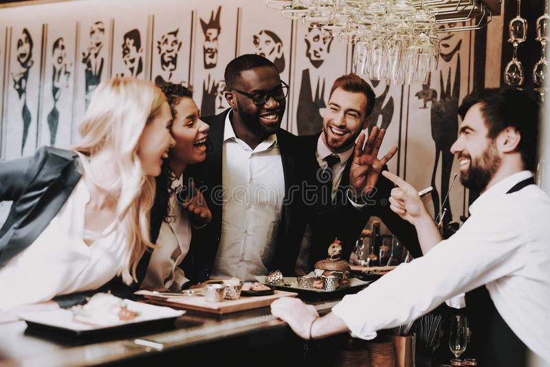 Drink Alcoholic Beverages. Young People. Joyful. Drink Alcoholic Beverages. Young People. Two Guys Girls Bar Different Races Communicate. Rest Have Fun royalty free stock image