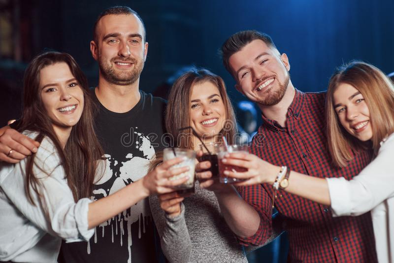 Drink all night long. Beautiful youth have party together with alcohol in the nightclub stock photos