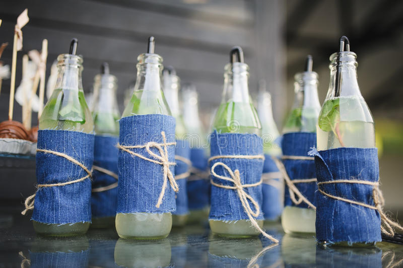 Drink bottles boho style. At a wedding reception party stock images