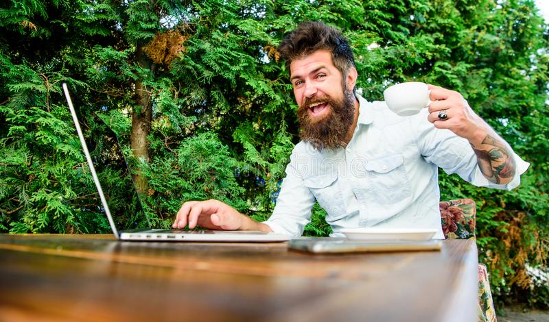 Drink coffee work faster. Bearded man freelance worker. Remote job. Freelance professional occupation. Caffeine booster. For productivity. Online blog. Blogger stock photo