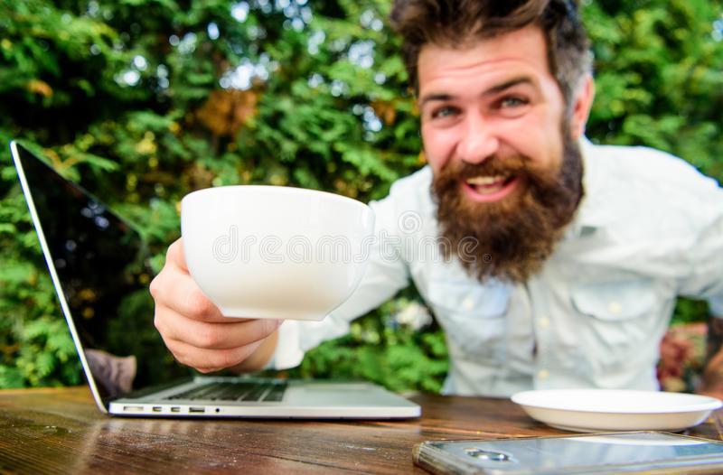 Drink coffee work faster. Bearded man freelance worker. Remote job. Freelance professional occupation. Online blog. Caffeine booster for productivity. Blogger royalty free stock photography