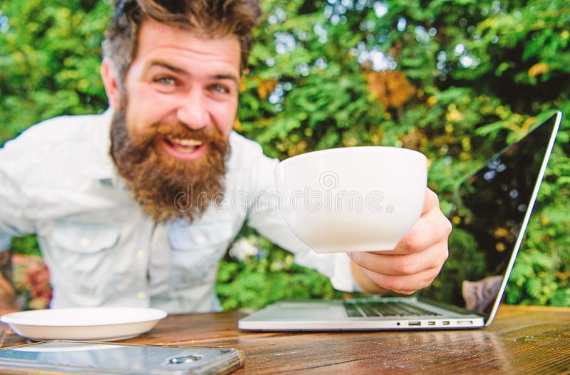 Drink coffee work faster. Bearded man freelance worker. Remote job. Freelance professional occupation. Online blog. Caffeine booster for productivity. Blogger royalty free stock images