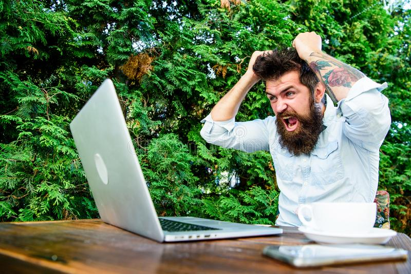 Drink coffee and work faster. Deadline is coming. Bearded man freelance worker. Remote job. Freelance professional. Occupation. Hipster busy with freelance royalty free stock images