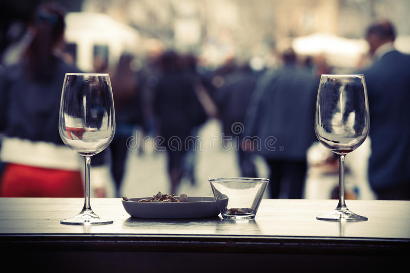 Drink consumed in cities street with crowd people royalty free stock images