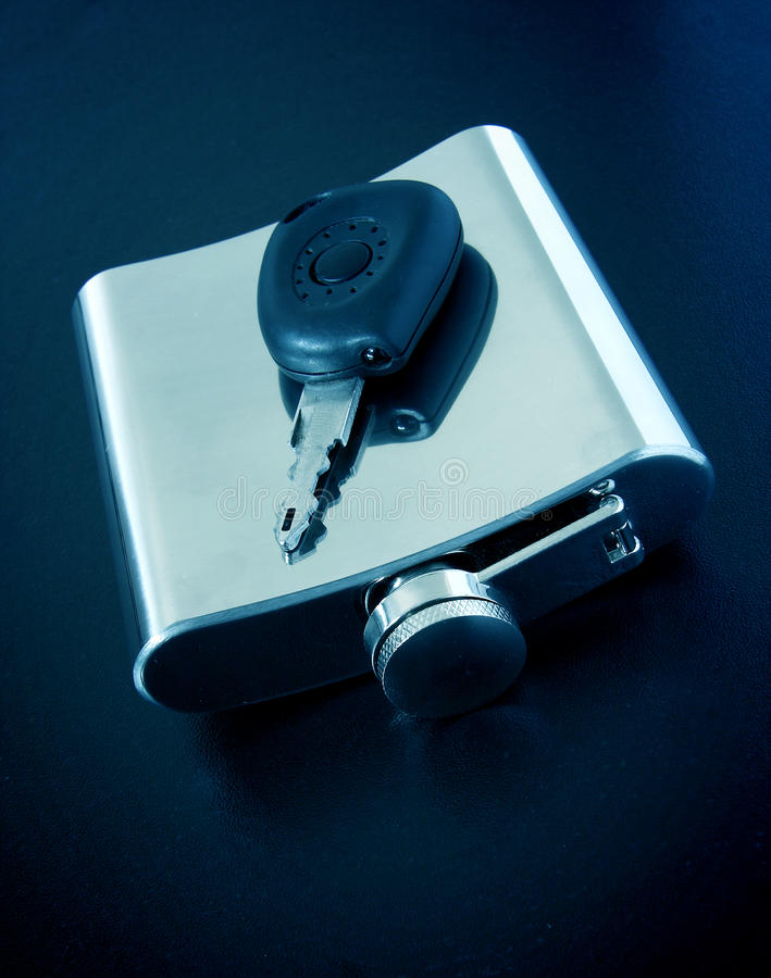 Drink and drive concept. Car key and flask royalty free stock photo