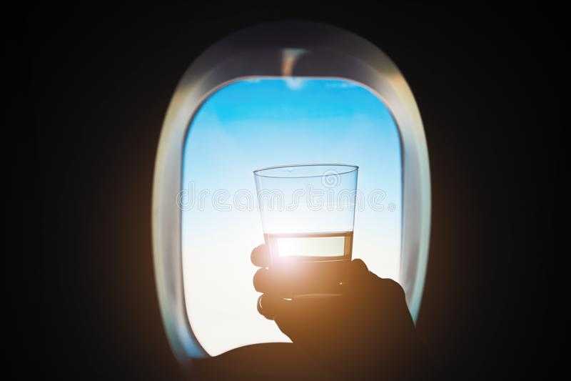 Drink during the flight stock photos
