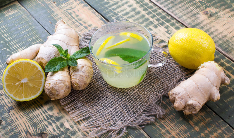Drink about ginger and lemon juice. On an old table stock photo
