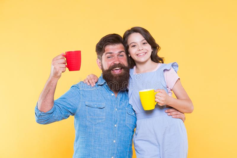 Drink healthy live well. Happy family drink milk tea. Little child and father hold cups of hot drink. Drinking natural stock photography