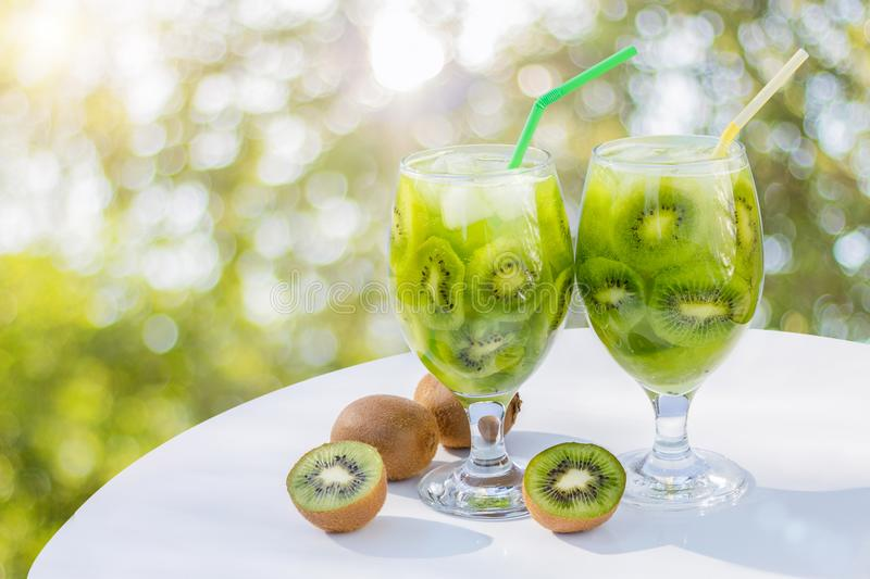 Drink from kiwi in the glass . Drink from kiwi in the glass on the table royalty free stock photos