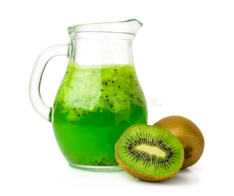 Drink with kiwi in a glass jug. Isolated on white stock photography