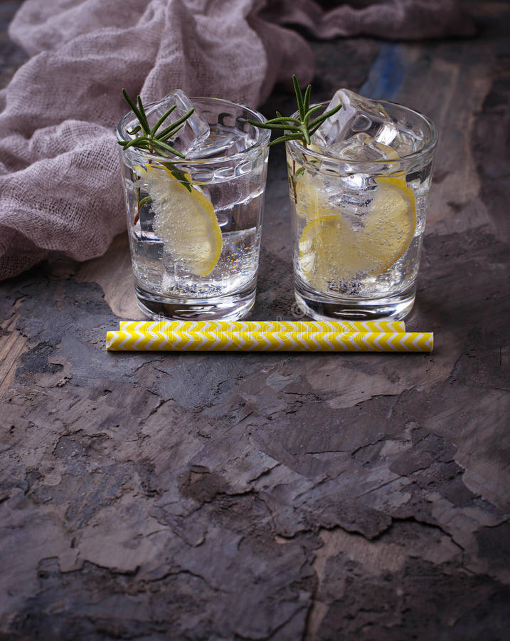 Drink with lemon and rosemary. Selective focus stock images