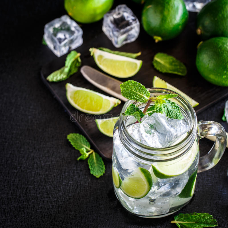 Drink with lime, mint and ice. Cold drink with lime and mint in a glass stock photos