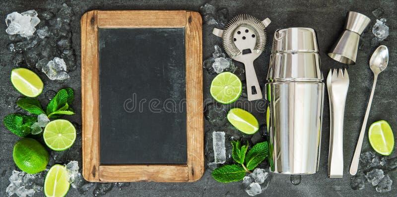 Drink making tools ingredients Lime mint blackboard stock image