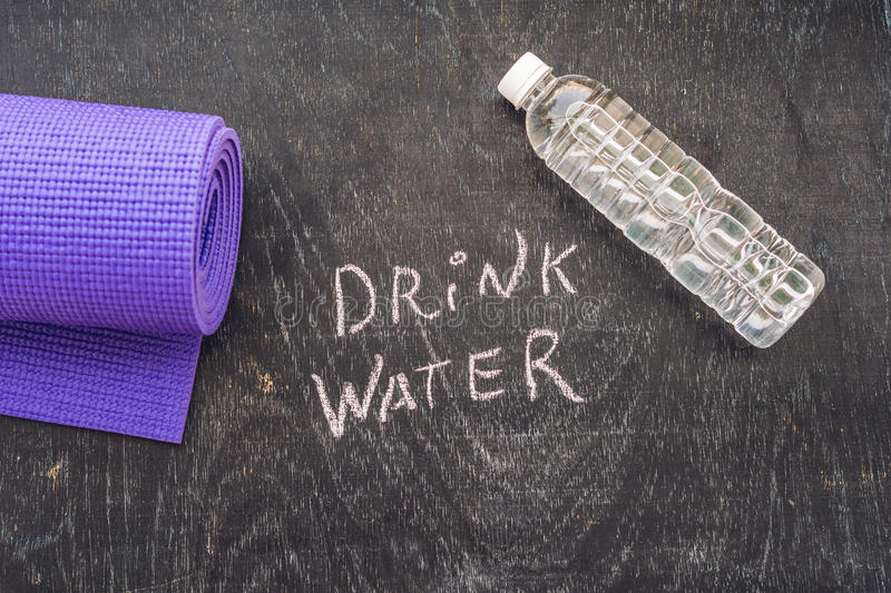 Drink more water - hydration reminder - handwriting on On a chalk board.  royalty free stock photo