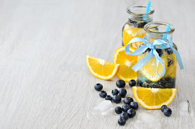 Drink with orange blueberries and ice cubes stock photo