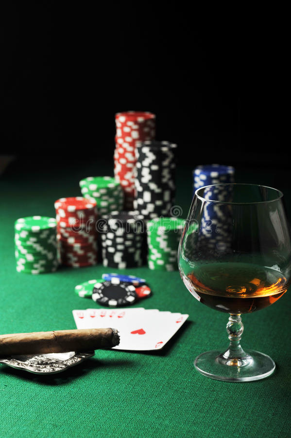 Drink and playing cards stock image
