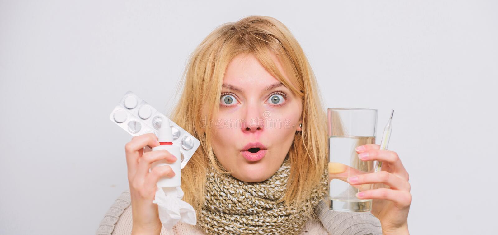 Drink plenty of fluids. Girl take medicine to break fever. Breaking fever concept. Headache and fever remedies. Woman. Sick person hold glass water and tablets stock photo