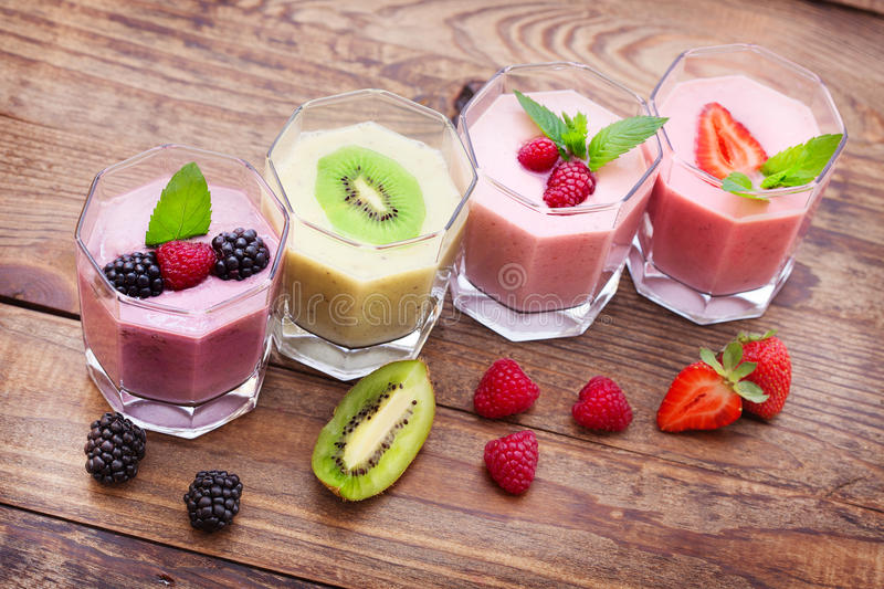 Drink smoothies summer strawberry, blackberry, raspberry on wooden table. stock photos