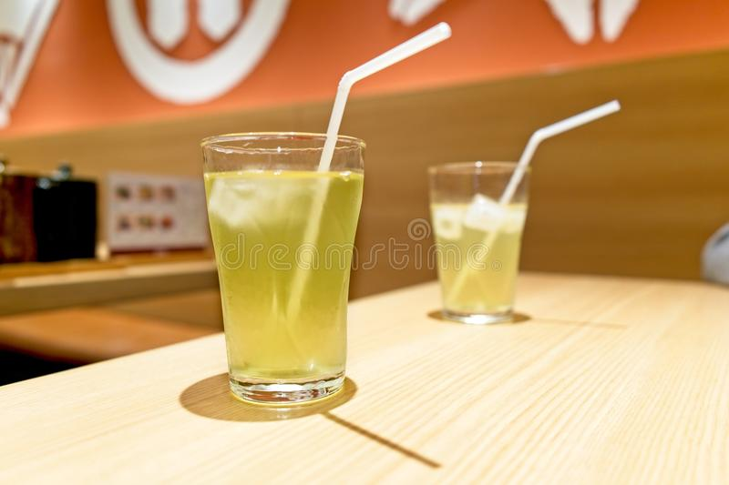 Drink of summer with copy space, two Iced Green tea on wood table, Glass of iced green tea. Drink of summer, two Iced Green tea on wood table, Glass of iced royalty free stock photo