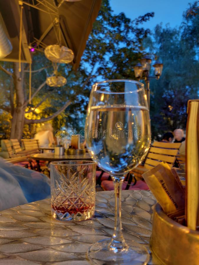 Drink in the summer evening. Glass, eveningphoto, alcohol, twilight, dusk, romantic, nopeople royalty free stock photo