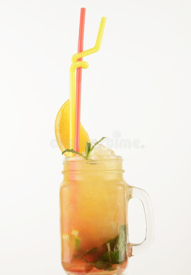 Alcoholic drinks with pieces of fruit royalty free stock image