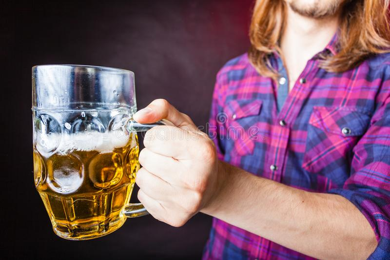 Young man drinking pint. Drinking alcohol liquor relax concept. Young man drinking pint. Male in shirt holding stein with beer royalty free stock image