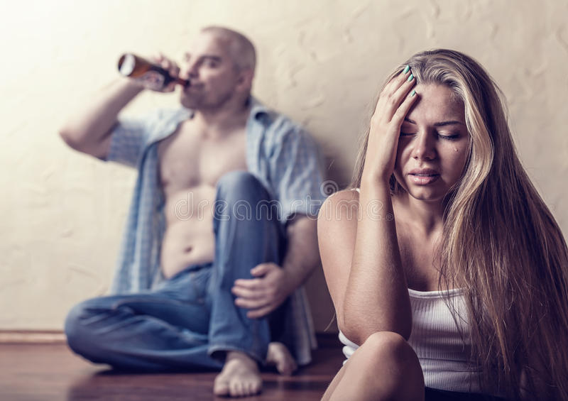 Drinking. Alcohol problems in the family. Focus on young women in tears royalty free stock photography