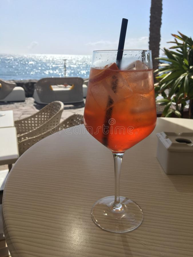 Aperol. Drinking aperol spritz coctail royalty free stock image