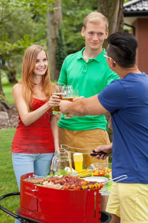 Drinking beer on a garden party royalty free stock image
