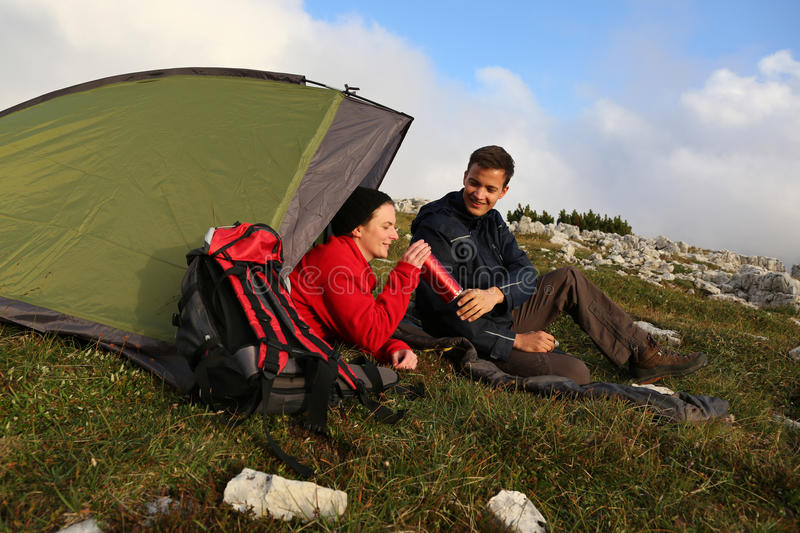 Drinking while camping in the mountains royalty free stock photography