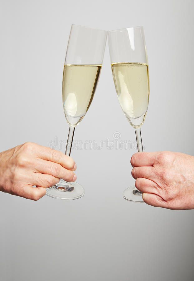 Drinking champagne for celebration royalty free stock photography