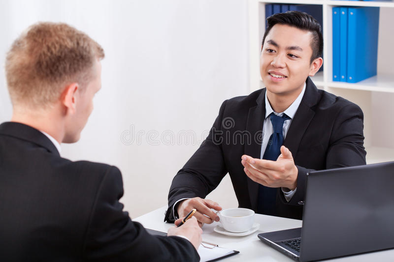 Drinking coffee on business meeting stock photos