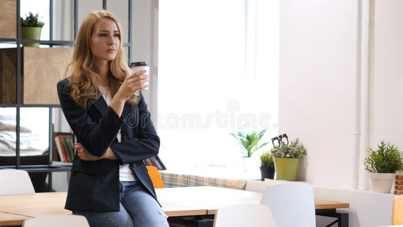 Drinking Coffee Businesswoman, Sitting on Desk stock photos