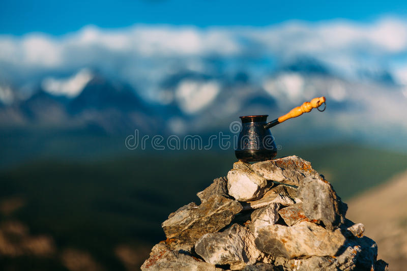 Drinking coffee with stunning mountain view. Beautiful Himalayas landscape with coffee cups and cezve. Drinking coffee royalty free stock images