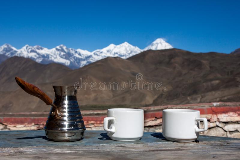 Drinking coffee with stunning mountain view. royalty free stock image