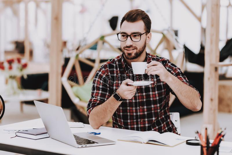 Drinking Coffee. Young Guy. Businessman. Work royalty free stock photo