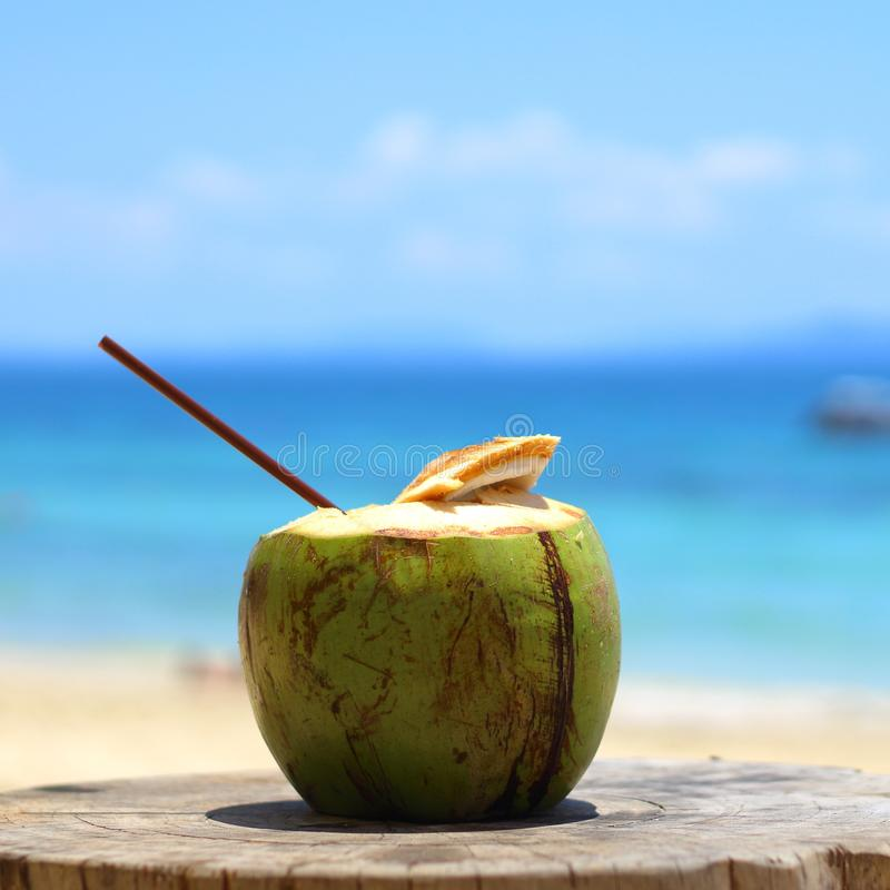 Coconut juice on the beach royalty free stock image