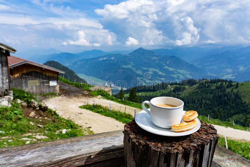 Drinking a cup of caffee with breakfast over the mountains in tyrol on a hut terrasse royalty free stock photo