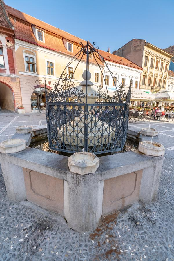 Drinking fountain on the central square of the Romanian Brasov. One of the ten largest cities in Romania. Located in the heart of Romania, the city of Brasov is stock images
