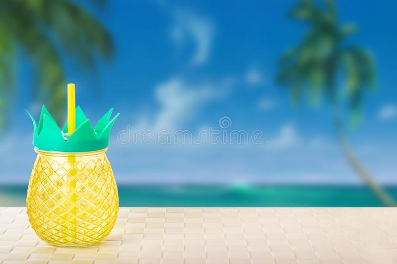 Drinking a fresh ananas juice from ananas glasses at he tropical royalty free stock images