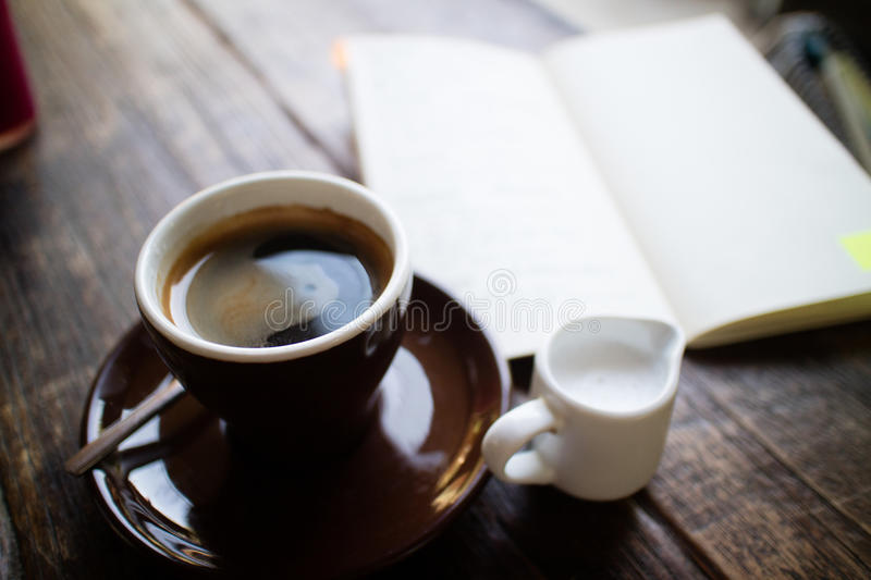 Coffee & journal royalty free stock photography