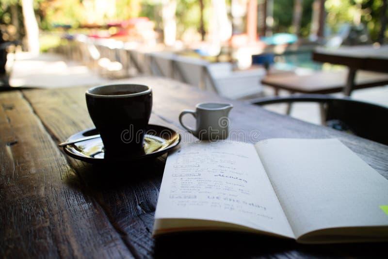 Planner & espresso coffee royalty free stock photo
