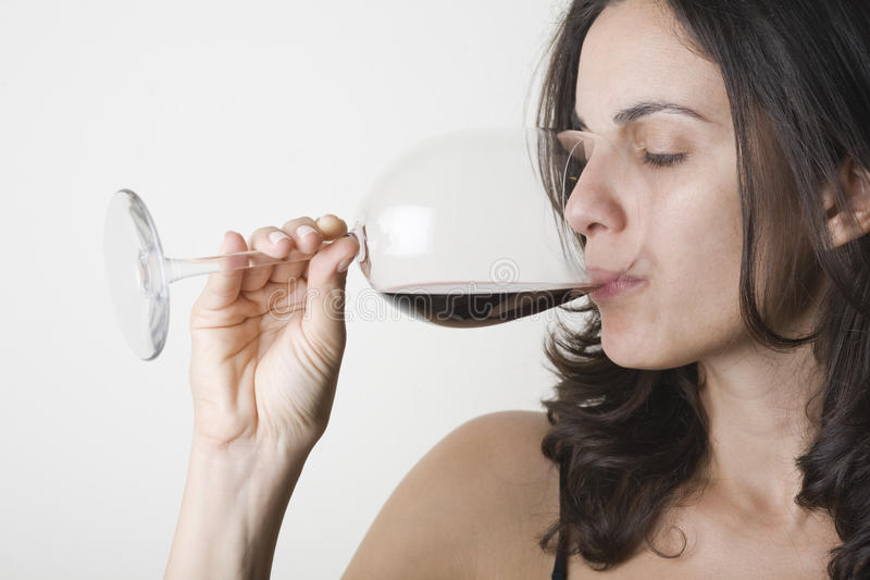 Drinking red wine stock image