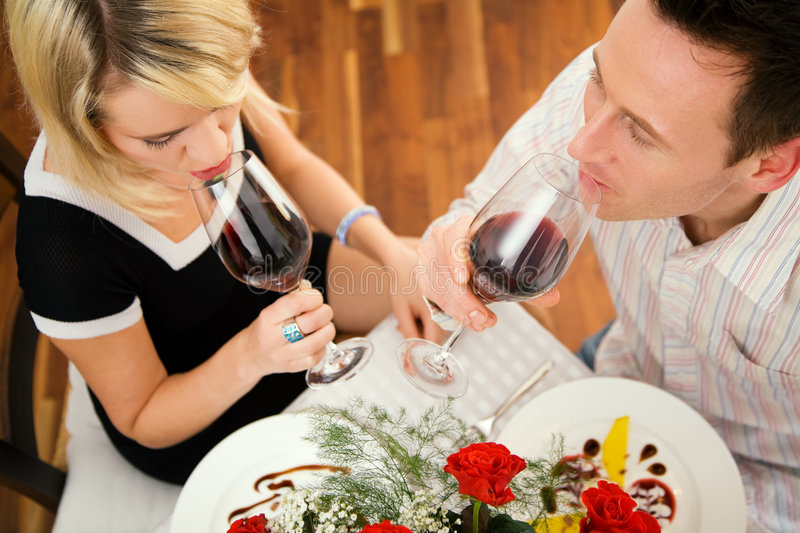 Drinking red wine royalty free stock photography