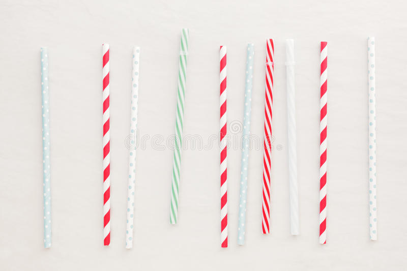 Drinking straws background. Different drinking straws over white background. Top view, blank space stock images