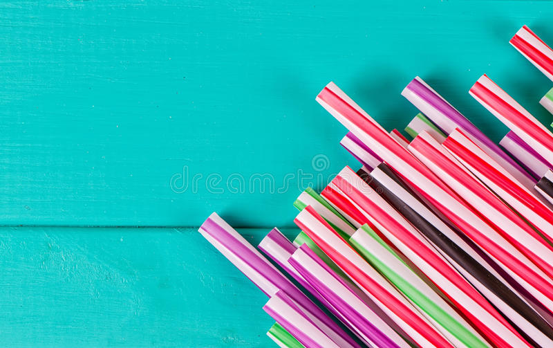 Drinking straws for party on blue pastel background with copy space. Top view royalty free stock photography