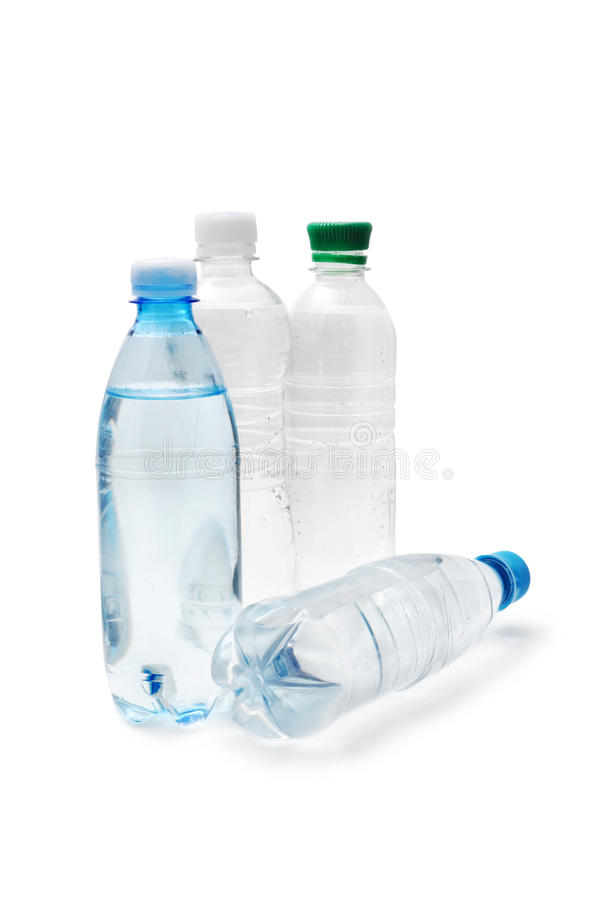 Drinking water. Transparent plastic bottle with aerated drinking water royalty free stock photography