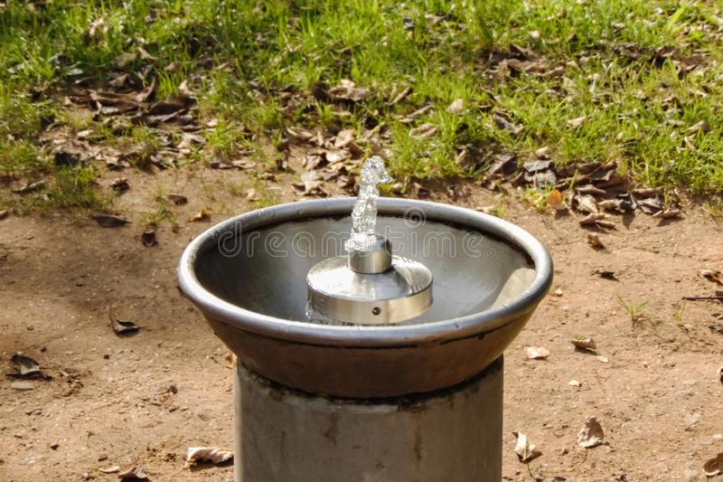 Drinking water fountain in the park close up stock photo