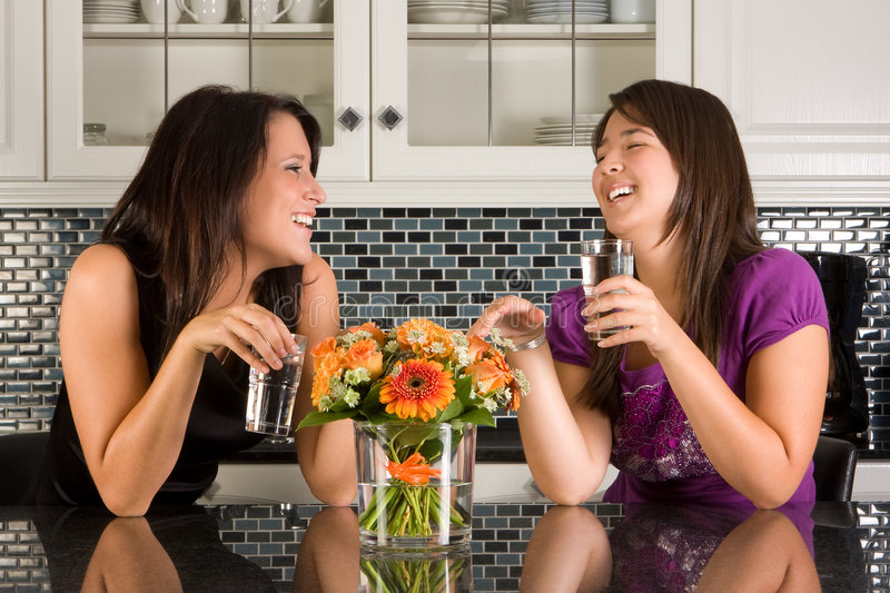 Drinking water in the kitchen royalty free stock image
